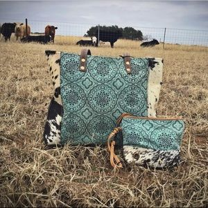 Myra Cowhide Tote and clutch